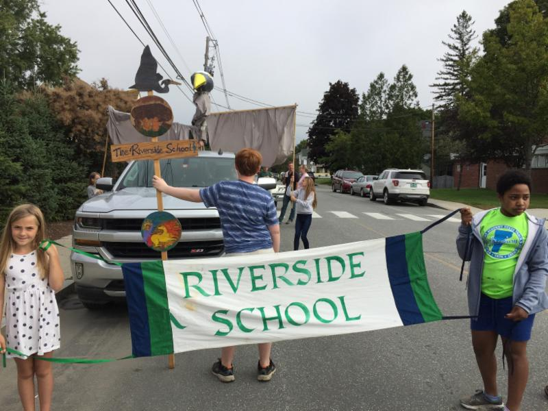 4th grader Esme and 5th grader Izzy led Riverside's float at the Colors of the Kingdom parade in St. Johnsbury.
