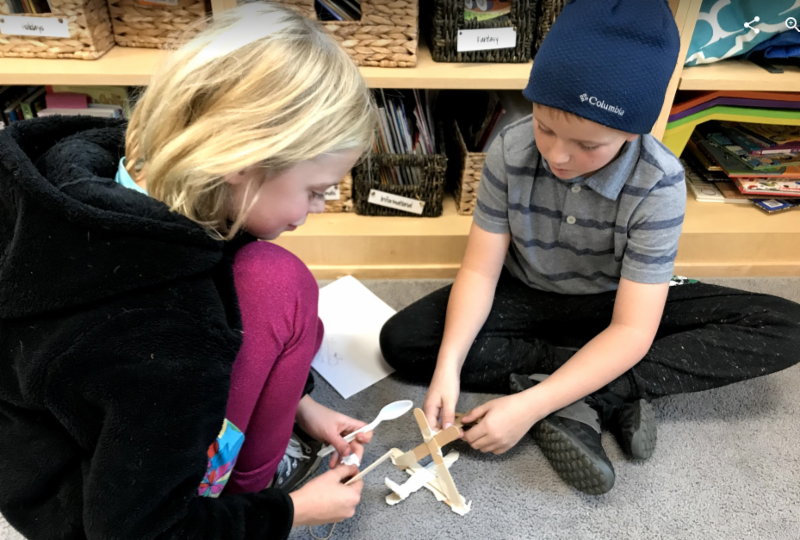 4th grader Molly Aeberhard and 2nd grader Carter Amidon are book buddies, and also worked together to design and build a catapult for pumpkin candies recently.