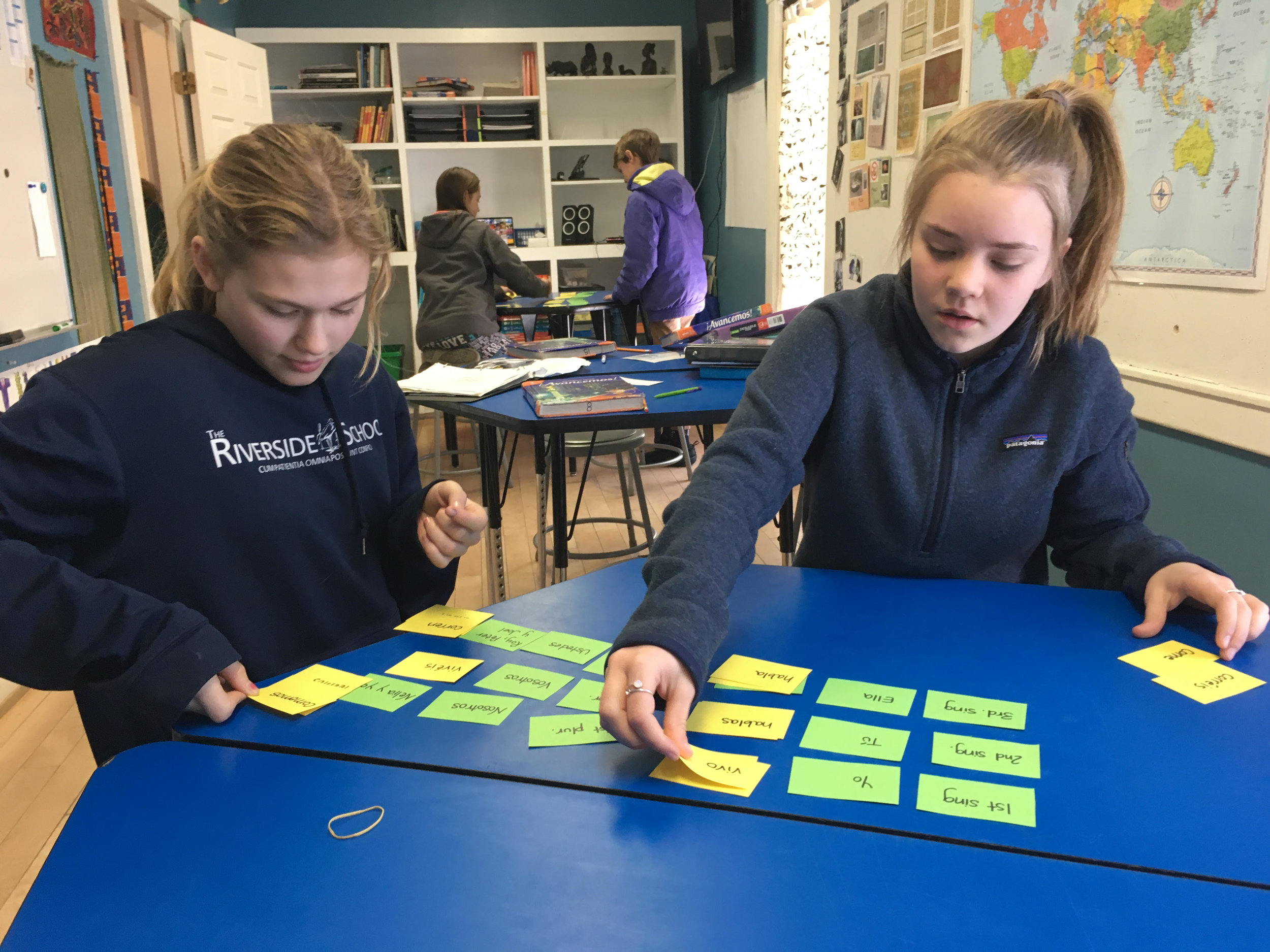 7th graders Lacey Patoine and Lila Cobb sorted out Spanish verb conjugations in their class with Nelia recently.