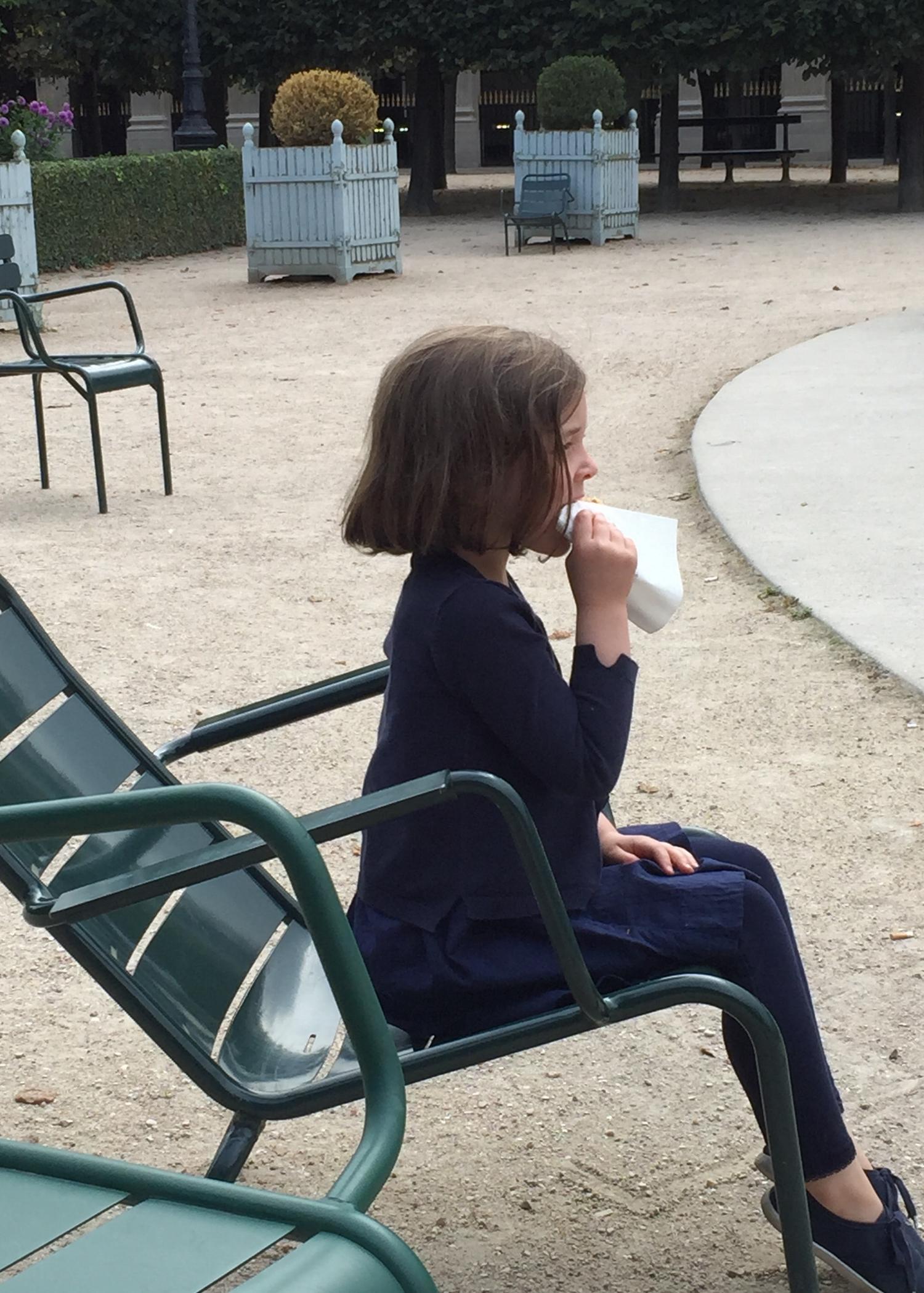 JARDIN DU PALAIS ROYAL, CROISSANT EATING, PARIS