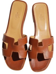 hermes-hermes-oran-flats-brown-sandals-14330419-0-1.jpg