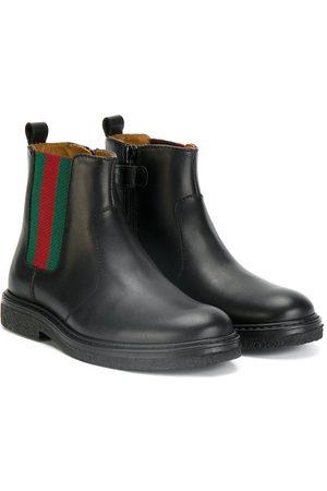gucci-web-trim-boots.jpg