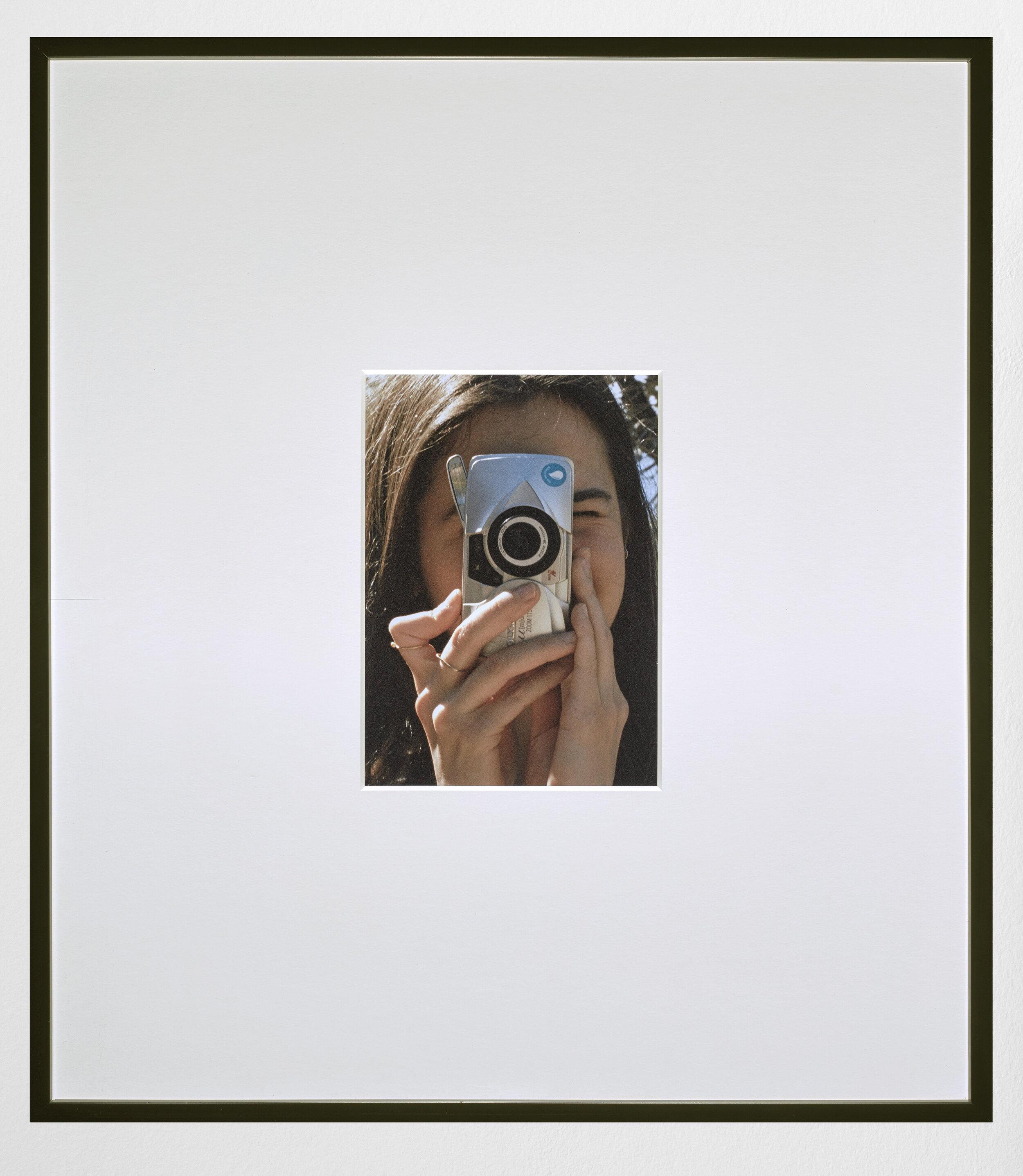 Lua with Camera , 2019, Archival pigment print, 11 x 7.75 inches