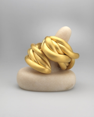 Cuff  — Louise Bourgeois, 2008 22kt yellow gold plated silver, pink marble stand