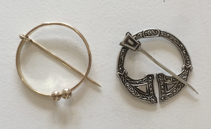 The pin Dong made for Ruth from her father's wedding rings and her Scottish brooch