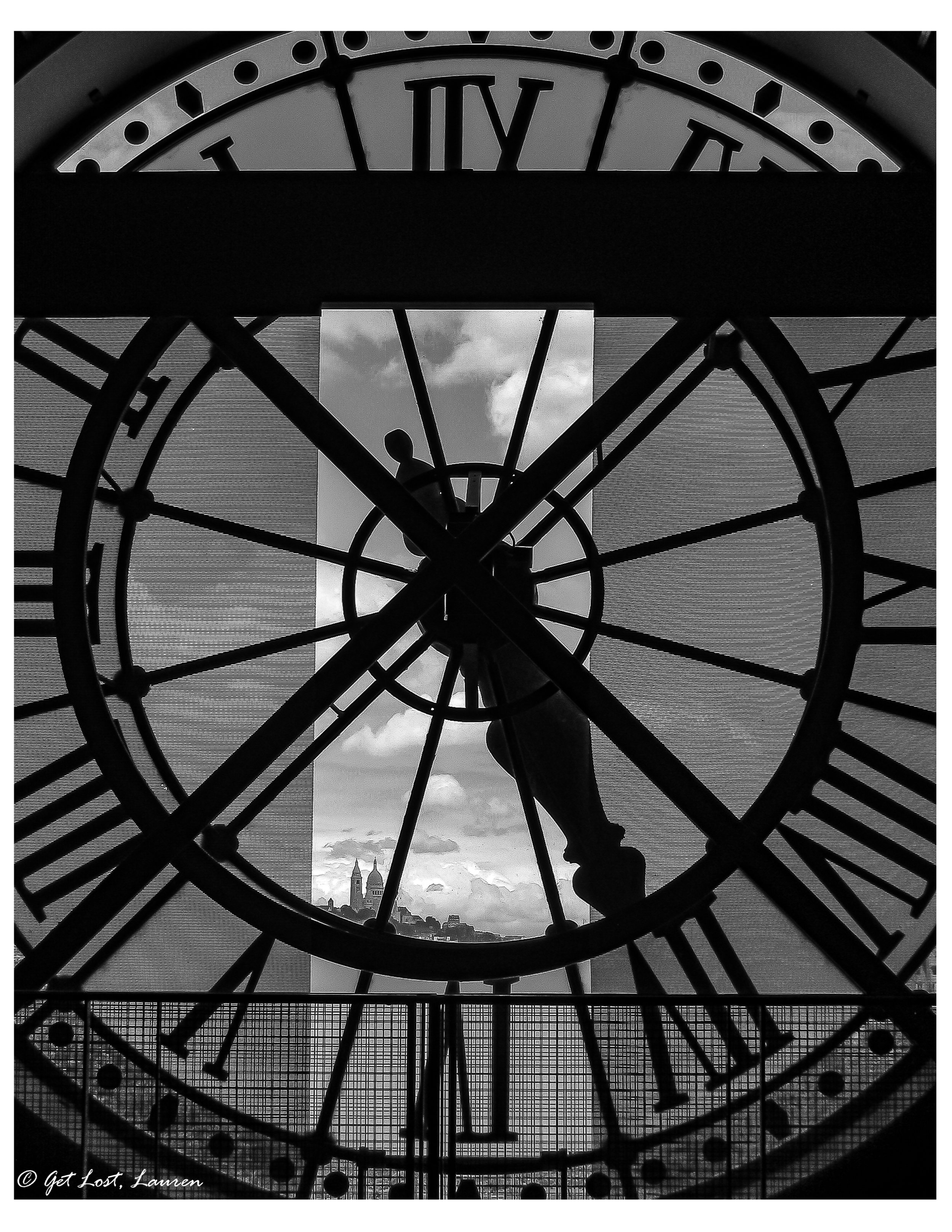 The Sacre Coeur peeking through the clock at the Orsay.