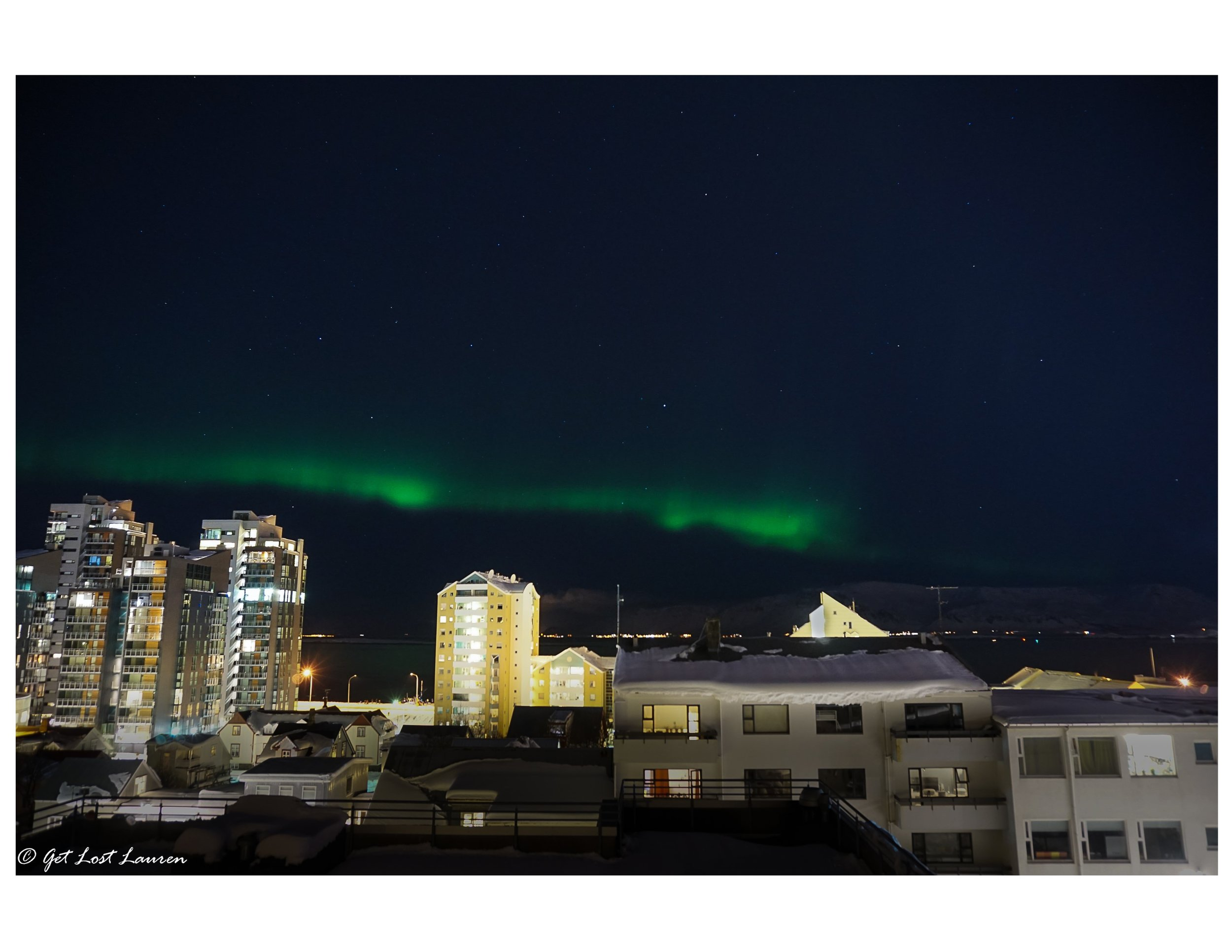 You might not have to go too far to see the Northern Lights. This was right off our apartment's balcony in Reykjavik! Sony a5000. f4/ISO 800/4""