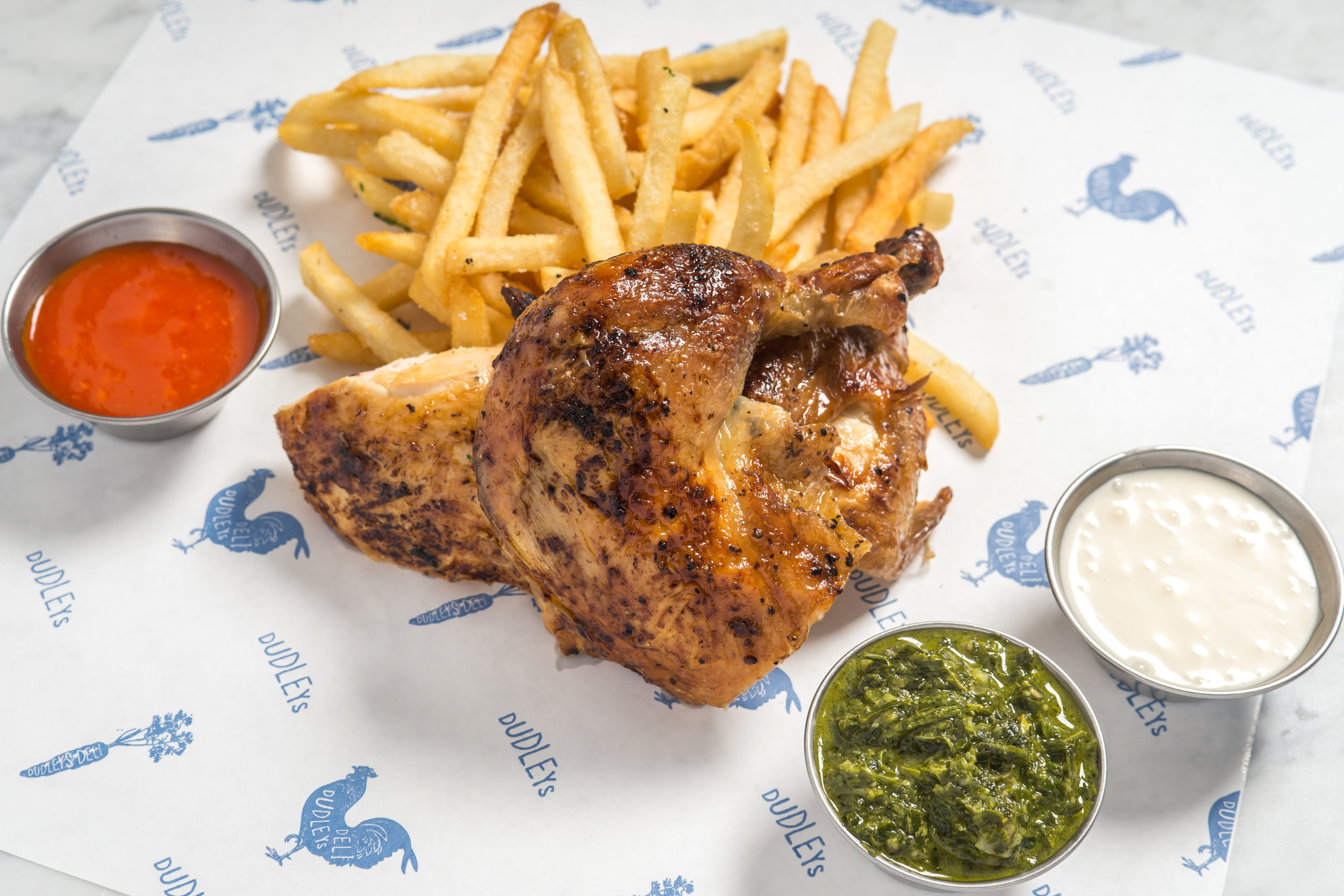 Half Chicken with Fries and Condiments (Photo Credit Paul Wagtouicz).jpg