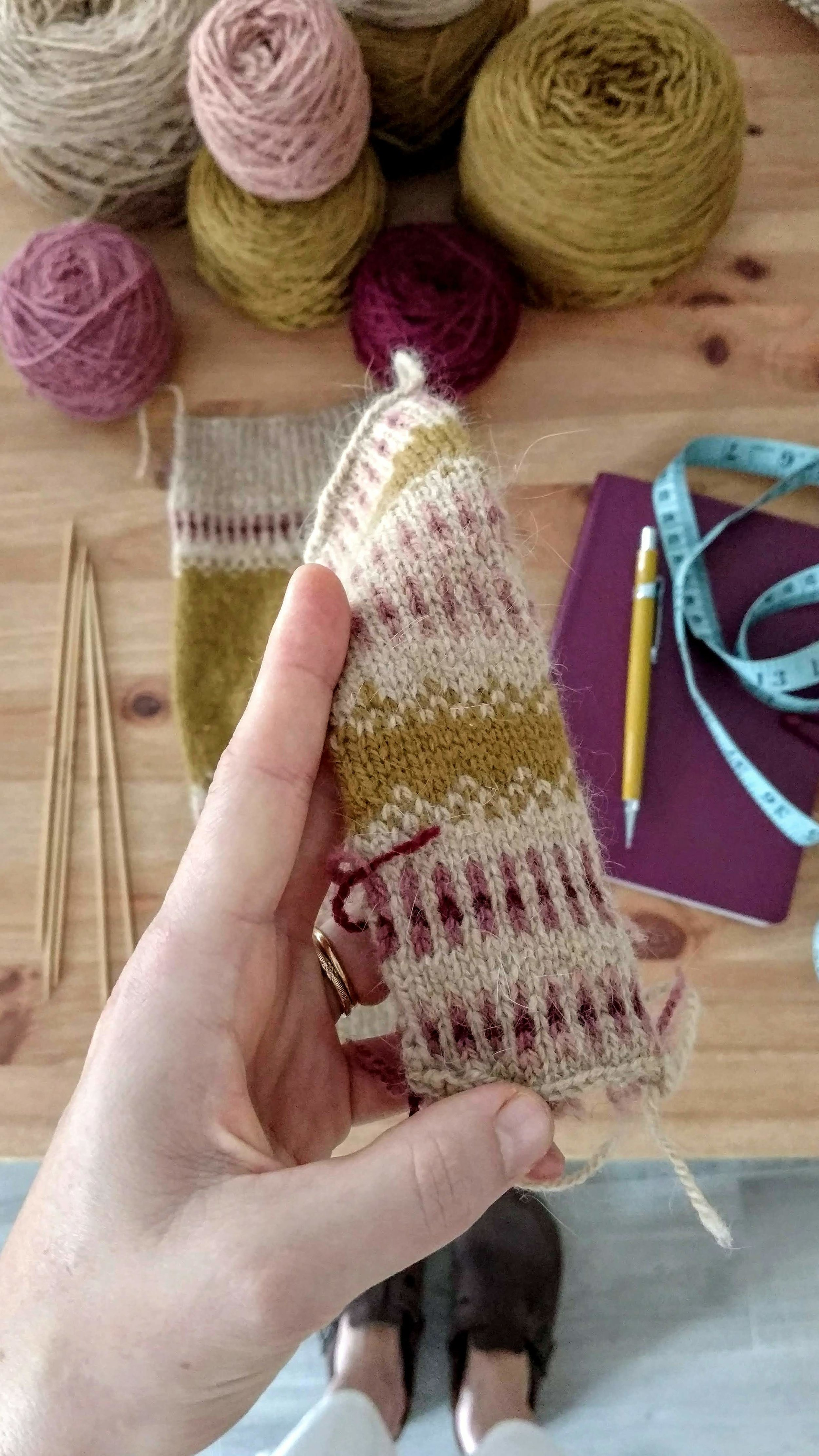The original knitting sample with the yarn that would become my sweater in the background.