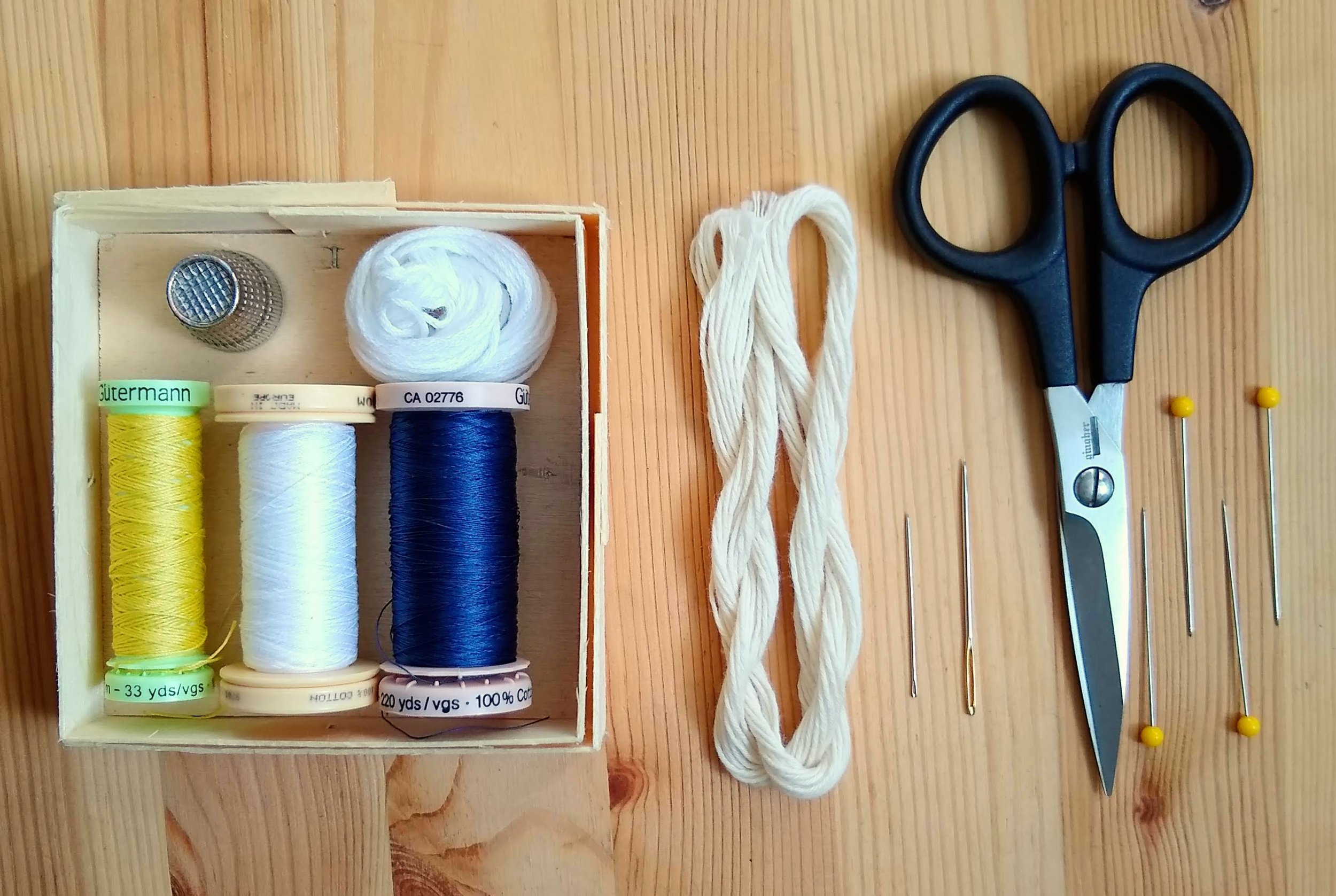 Mending haberdashery: Sewing thread (in colors to match patches and denim, standard thimble, embroidery floss or Japanese sashiko thread, a heavy duty sashiko or embroidery needle, a standard hand sewing needle, and sharp, pointy scissors.