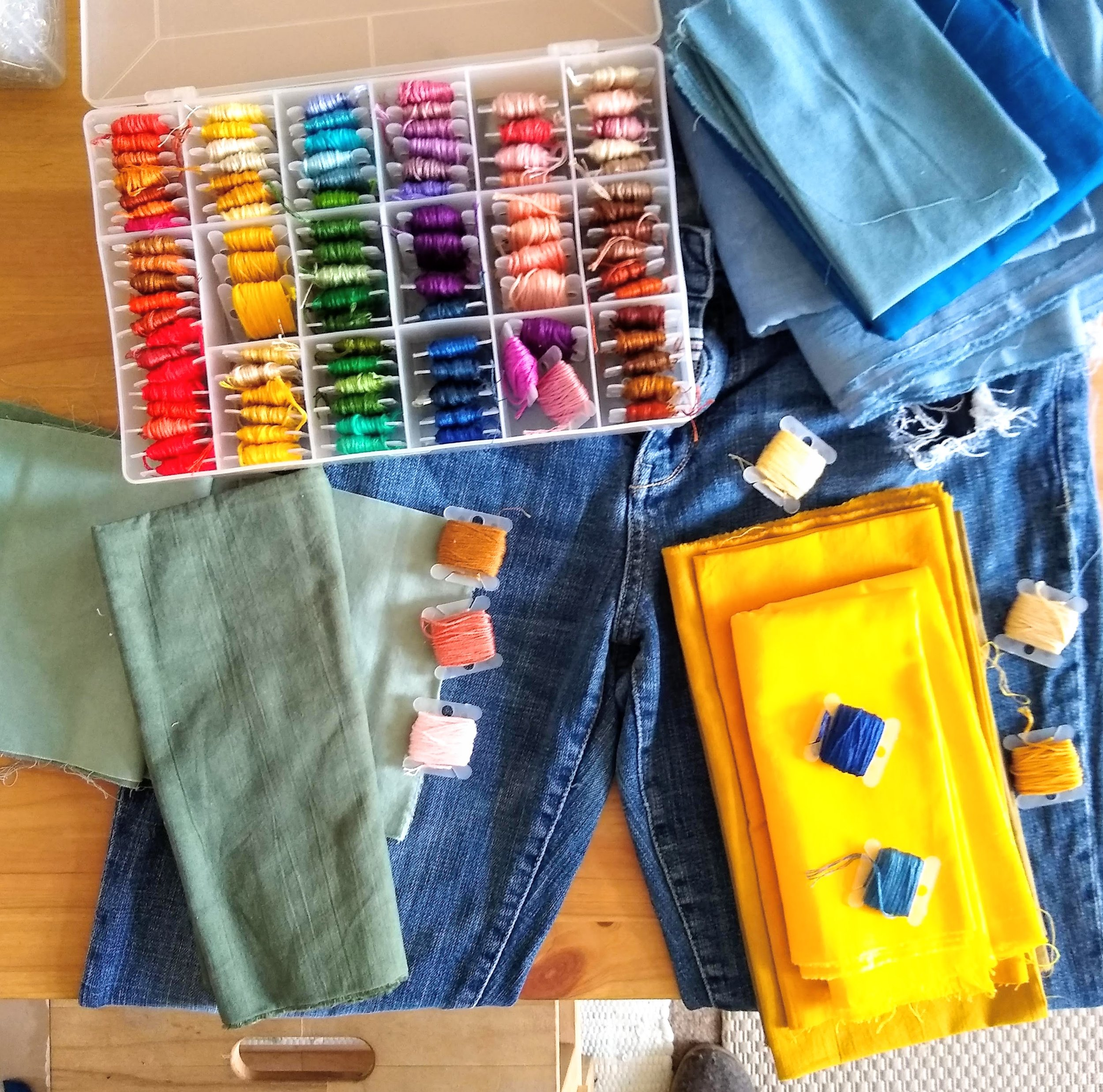 I am a big fan of taking out ALL the options and holding different options next to my mending project. Here I have a lot of hand dyed fabric that I set next to my garment to be mended and add my embroidery floss options to see what works well together.