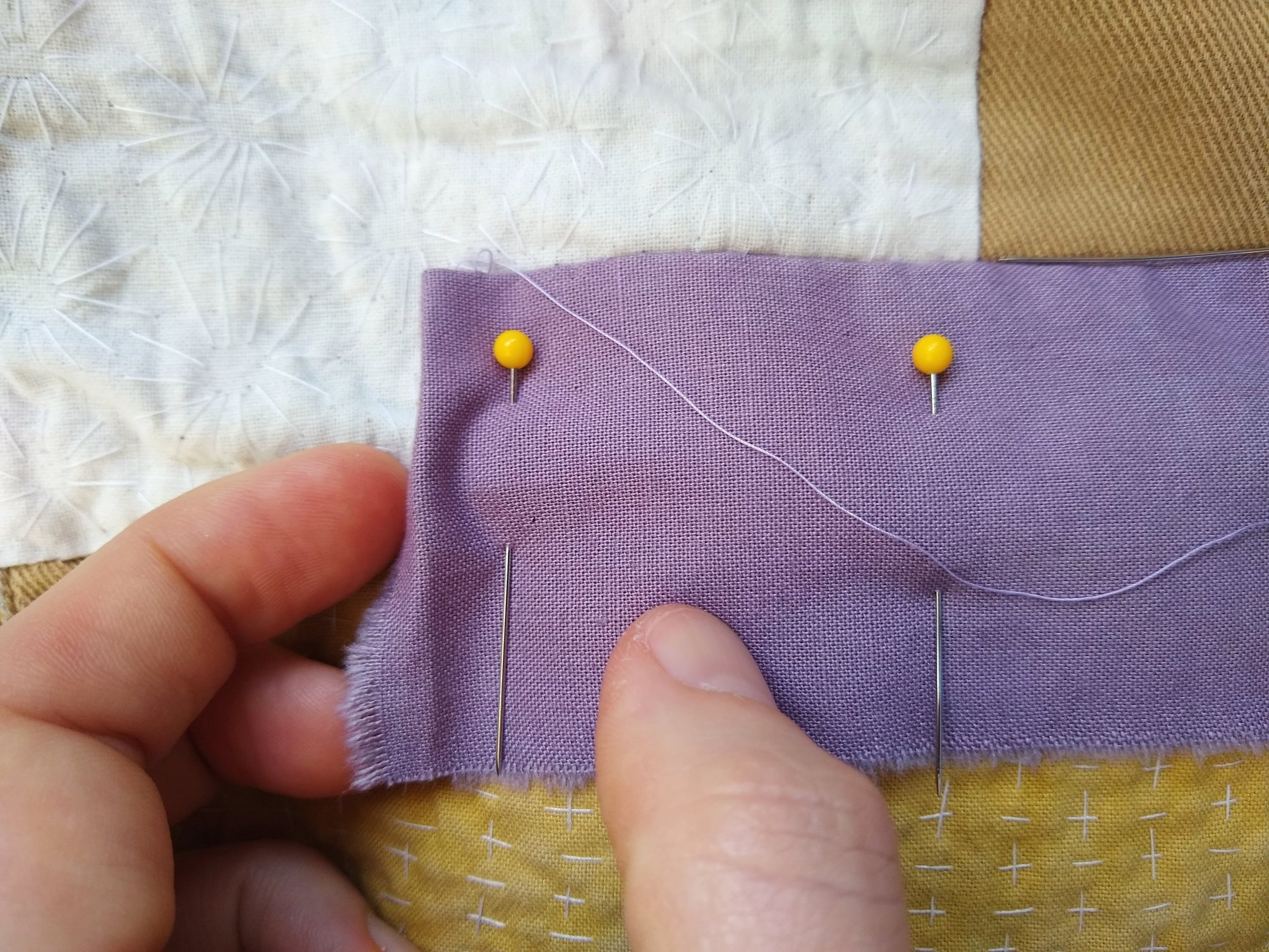 "Sew to 1/2"" before the next side, tuck under your next edge 1/4"" and repeat."