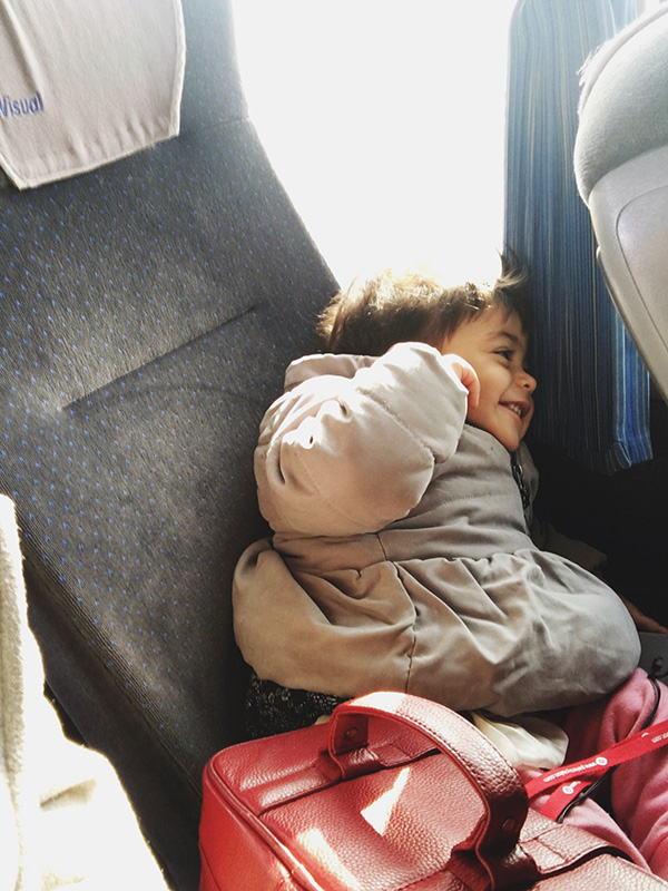 Layaan tuning out the bus.