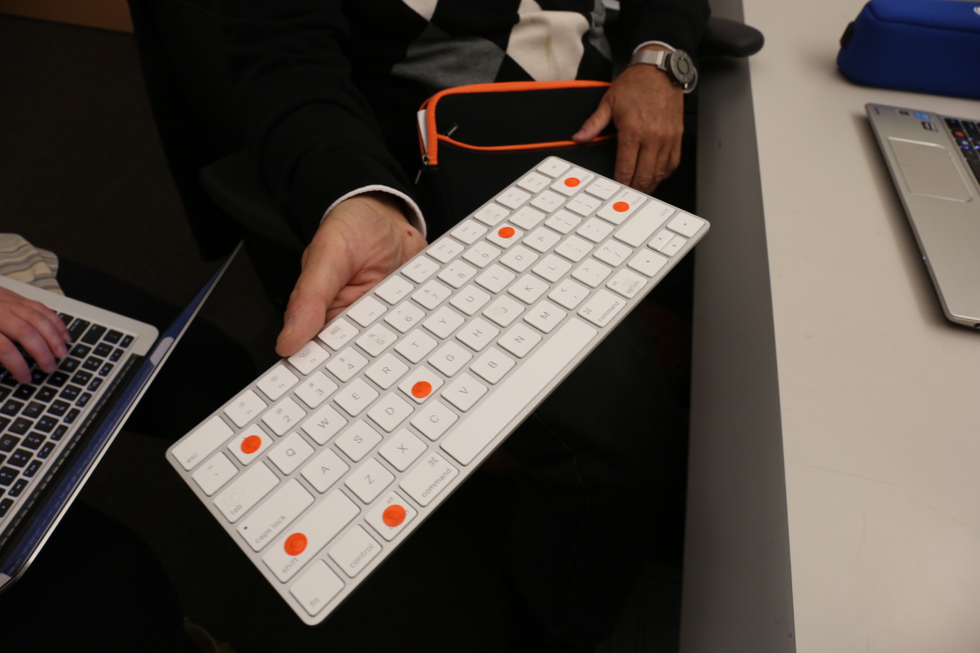 One PWVI interviewee customizes his bluetooth keyboard with tactile stickers to find his place while typing.