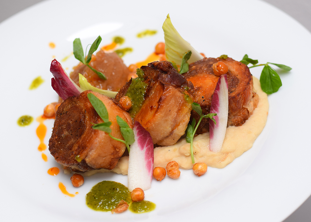 Rolled pork belly, crispy paprika pork skin, white bean puree, dukkha spiced apple sauce, crispy chickpeas, red and green chilli and pea shoots