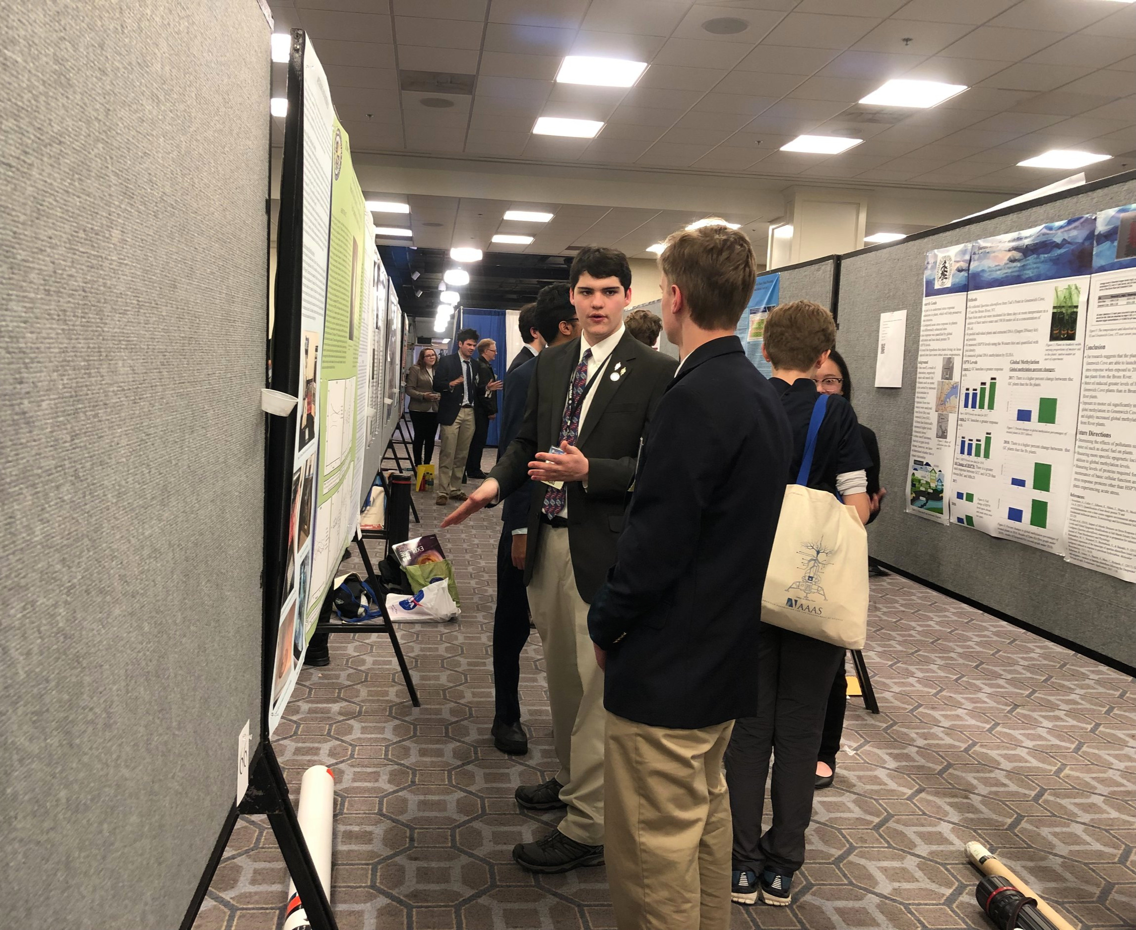 STUDENTS PRESENT THEIR POSTERS TO THE GENERAL PUBLIC & ATTENDEES OF THE AAAS MEETING
