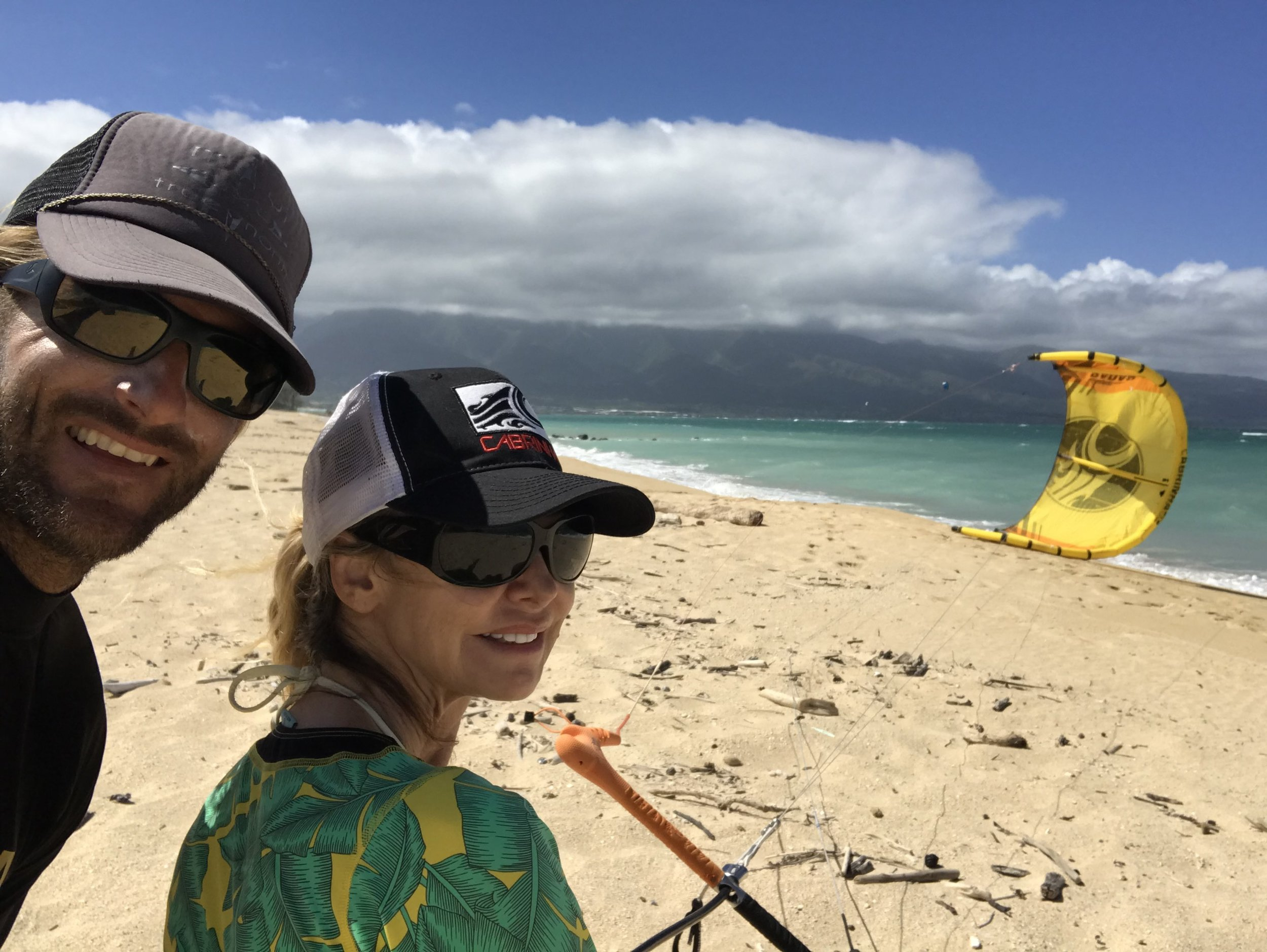 LISA CABRINHA  WITH  BRETT   SHEERIN  FLYING THE KITES WITH HER NAME ON IT! PETE WAS PROUD!
