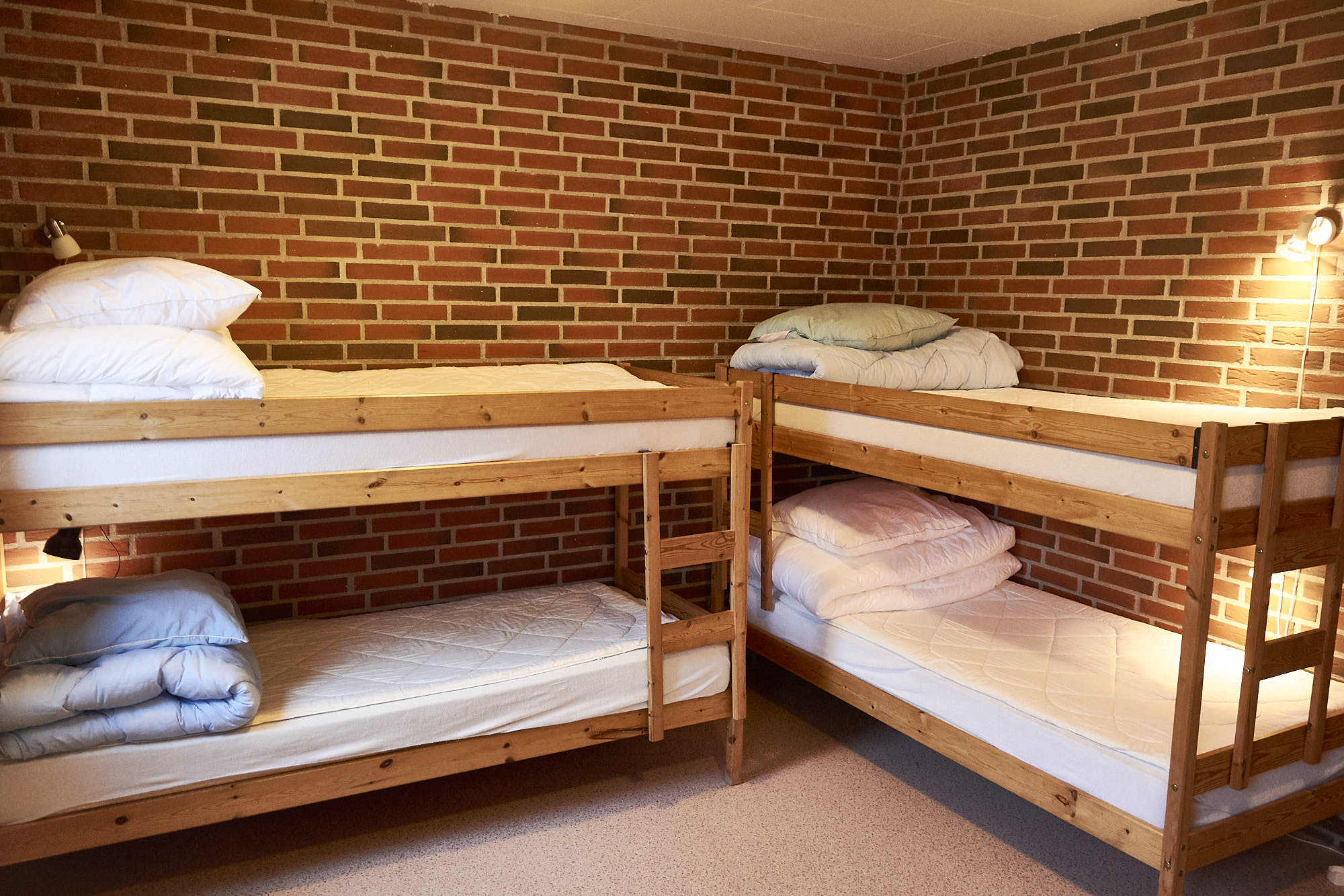 Room 3: Four bunk beds and a table