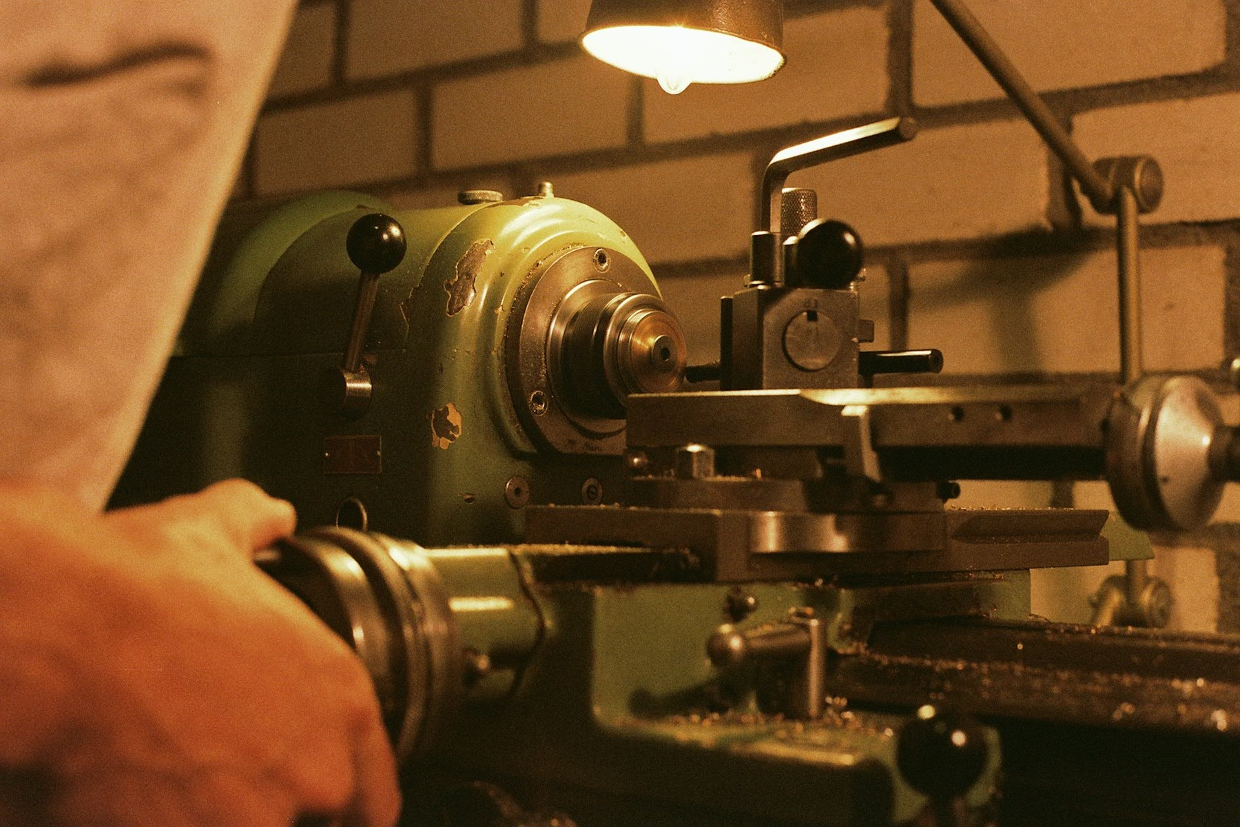 Turning a case behind our Schaublin 102 lathe.