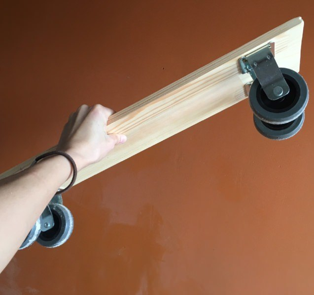Bottom Plank - I found it easier to start assembling my pantry shelf with the bottom part. I chose heavy duty non-swivel and non-locking casters. I think swivel casters are unnecessary here and may cause problems in such a tight space if a wheel turns and gets stuck.The most important thing here is to perfectly align them and to spread them as far apart as you can for additional stability.I saw that some people used only 2 casters in their DIYs, but I decided that my pantry shelf should be able to stand upright on it's own when it's pulled out.Side note: of course I couldn't help taking a little ride on this thing around our apartment as soon as I mounted the casters :)