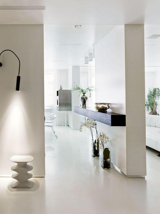 https://www.digsdigs.com/striking-minimalist-living-space-in-white-yellow-and-dark-wood/