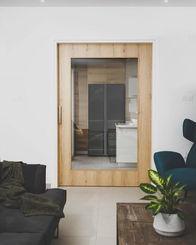 Large glass sliding door for a residence in Larnaca. . . . . .  #door #slidingdoor #partition #bespokejoinery #minimal #design #wood #oak #oakdoor #glassdoors #interior #interiordesign #kitchendoor #woodendoor