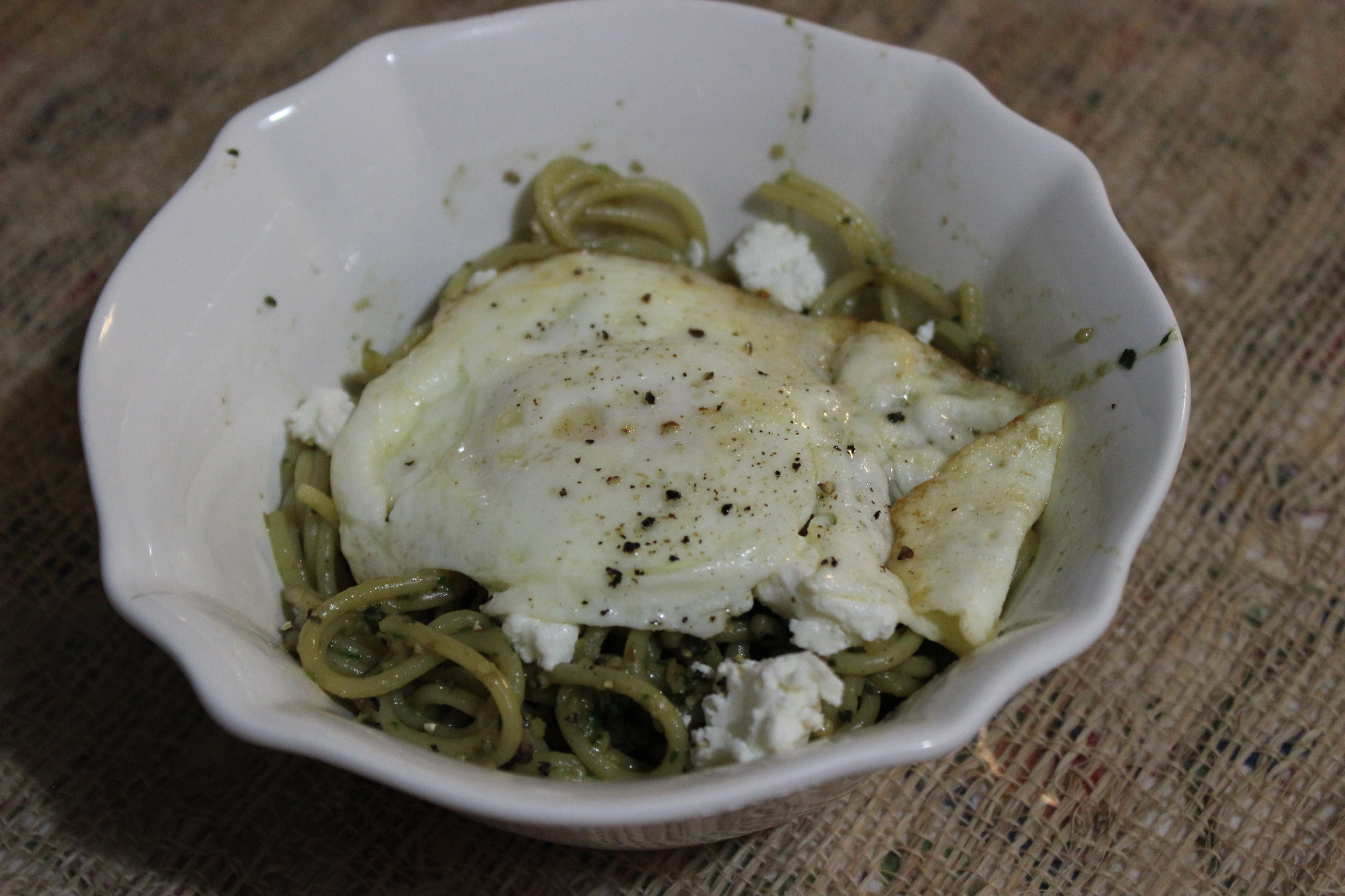 This was only one of our pesto fueled concoctions this time. It's simple. We tossed spaghetti in pesto, then topped it with goat cheese and a fried egg. I demolished my bowl about 5 minutes after I snapped this picture.