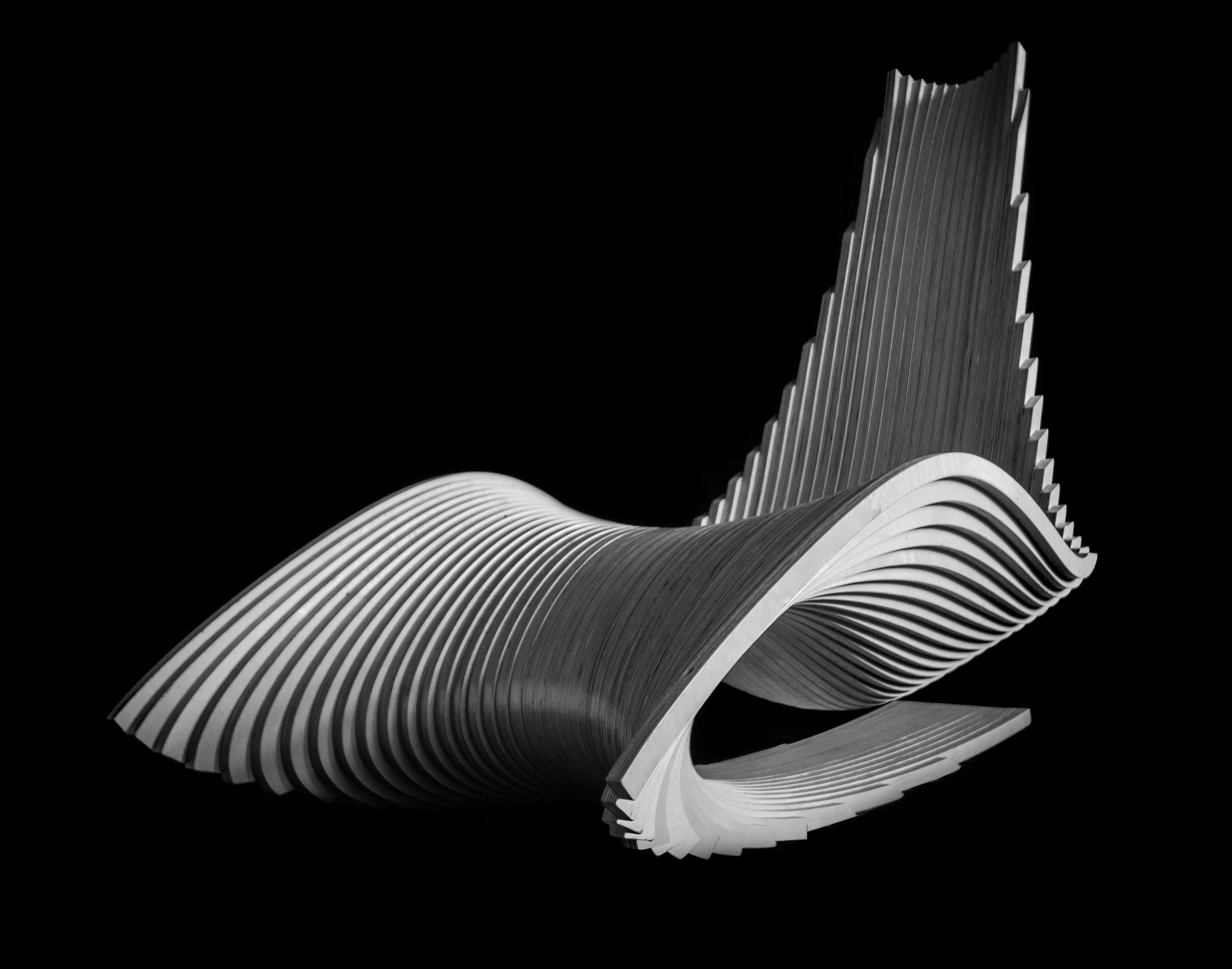 Ahmed El Husseiny/AE Superlab.   The Diwani Chair , 2015. Atlantic birch plywood. 42 x 31 x 53 in. Courtesy of Ahmed El Husseiny/AE Superlab. 2016.AES.01.  Photo:  Ahmed ElHusseiny/AE Superlab  METHOD: CNC router, hand block sander