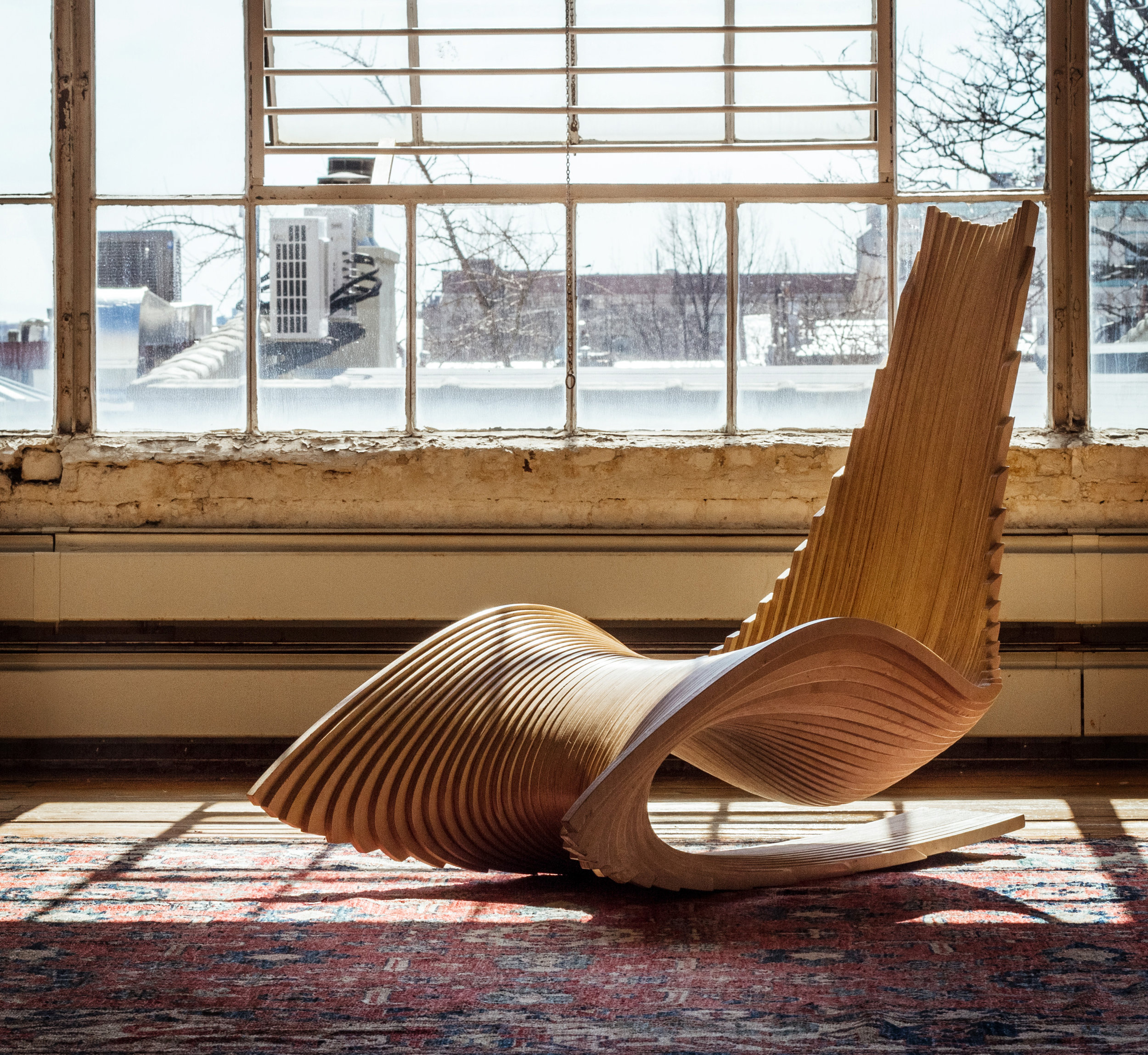 Ahmed El Husseiny/AE Superlab.  The Diwani Chair , 2015. Atlantic birch plywood.42 x 31 x 53 in.Courtesy of Ahmed El Husseiny/AE Superlab.2016.AES.01. Photo:  Ahmed ElHusseiny/AE Superlab  METHOD: CNC router, hand block sander
