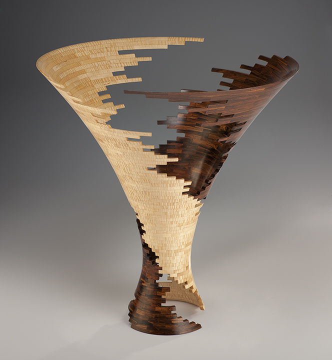 Bud Latven,  Spiral Impact 3 , 2007.Mexican cocobolo, American tiger maple.24 x 23 x 23 in.Courtesy of the Artist.2016.BL.01. Photo:  Robert Reck  METHOD: Schematic drawing: CAD, mathematical renderings of material components: Excel, table saw, band saw, thickness planer, stationary sander, thickness sander, pressure clamping, wood lathe, rotary carvers, hand and air file sanders, finish sanders, buffers