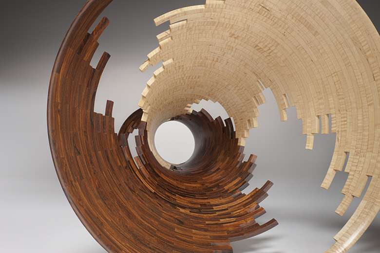 Bud Latven,  Spiral Impact 3 , 2007 (detail).Mexican cocobolo, American tiger maple.24 x 23 x 23 in.Courtesy of the Artist.2016.BL.01. Photo:  Robert Reck  METHOD: Schematic drawing: CAD, mathematical renderings of material components: Excel, table saw, band saw, thickness planer, stationary sander, thickness sander, pressure clamping, wood lathe, rotary carvers, hand and air file sanders, finish sanders, buffers
