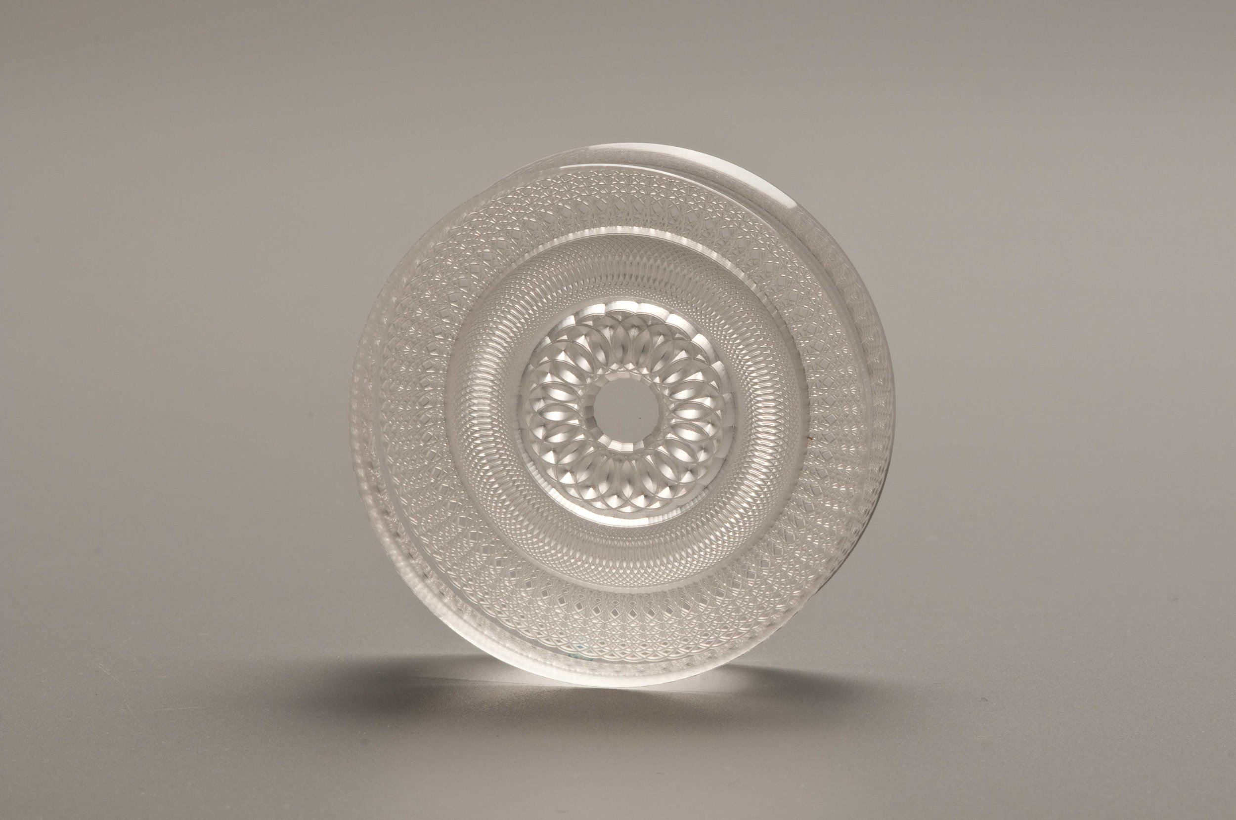 Fig. 26.   Dave Hardy, Ken Wurtzel, and Mark Krick, United States.  Paper Weight , 1992. Plexiglas, Computerized on HaWK lathe. 7/8 x 3 in. dia. Donated by the Artists. The Center for Art in Wood's Museum Collection. OBJ 905. Photo: John Carlano