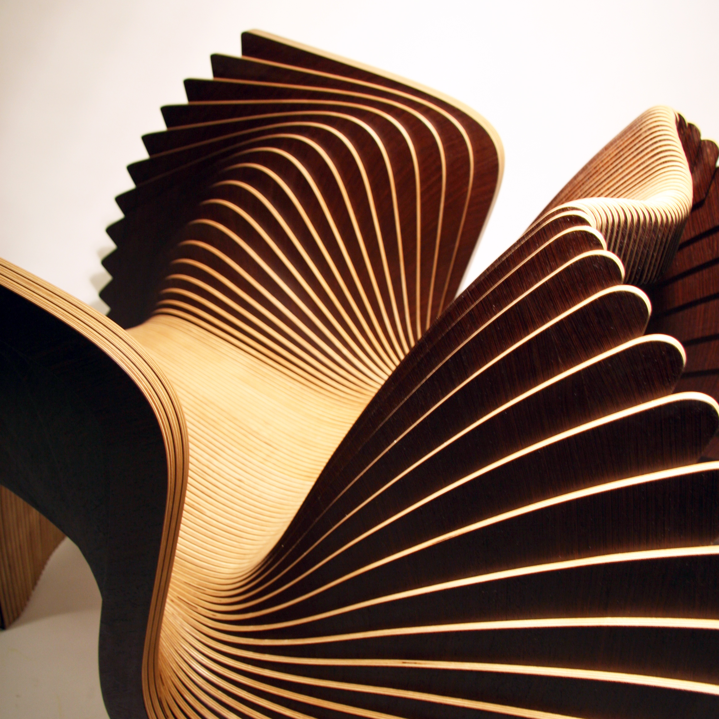 Alexander White.  Monroe Chair  , 2016 (detail).Maple veneer, Wenge veneer,  birch plywood.32 1/2 x 46 1/2 x 32 1/2 in. Courtesy of A. White Workshop.2016.AW.01.Photo: Courtesy of the Artist    METHOD: Veneer guillotine, veneer press, CNC router, electric sander, drill, clamps