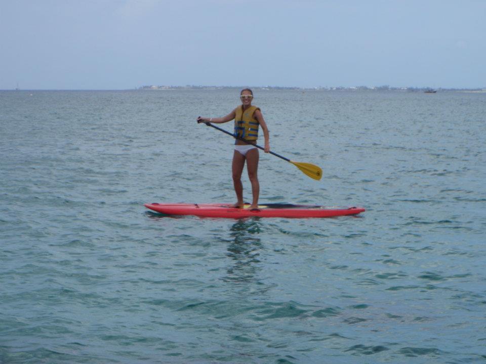 Keegan paddleboarding in Grand Cayman
