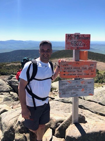 Tip #8: Spouses need self care. Andy hiking Mt. Moosilaukee.