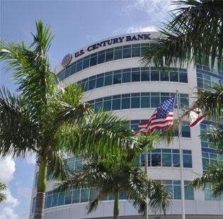 U.S. Century Bank turned a profit in the first quarter after taking a recovery from a previously charged off loan. MARK FREERKS