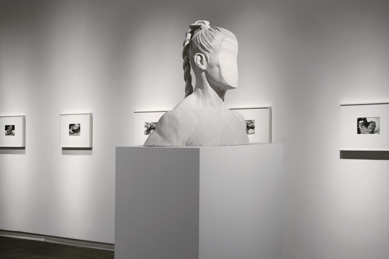 "Medusa (2013) cement, 21"" x 23"" x 12""   Untitled (Clay Portfolio) (2013) gelatin silver print, 7 3/4′′ x 5 3/4′′, from a portfolio of 21 images  Installation view of  Medusa  at Daniel Faria Gallery, Toronto, Canada"
