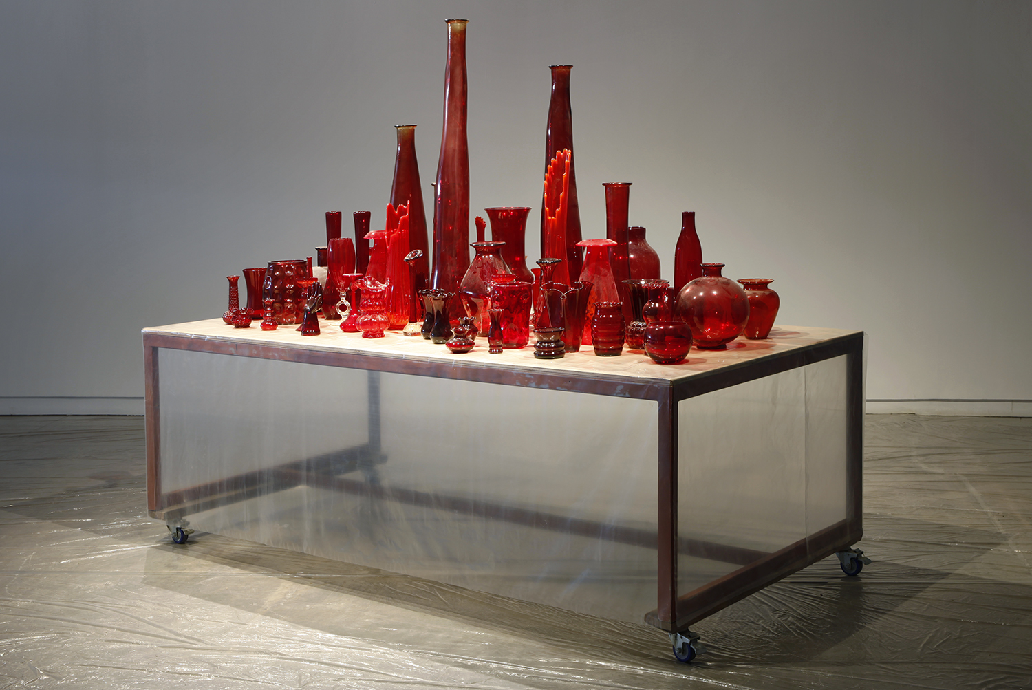 Red Vase Collection (ongoing) glass, size variable  Installation view at Scrap Metal, Toronto, Canada