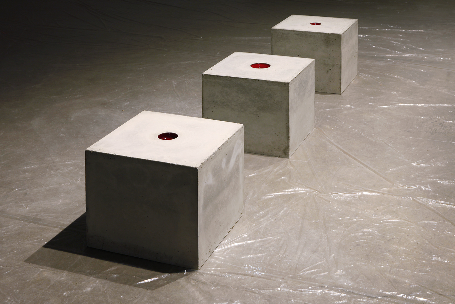 """Proud Flesh (2011) concrete and glass; 18"""" x 18"""" x 18""""  Installation view at Scrap Metal, Toronto, Canada"""