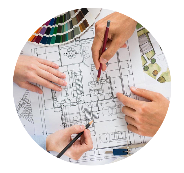 A team of designers reviewing and marking up an architectural plan drawing