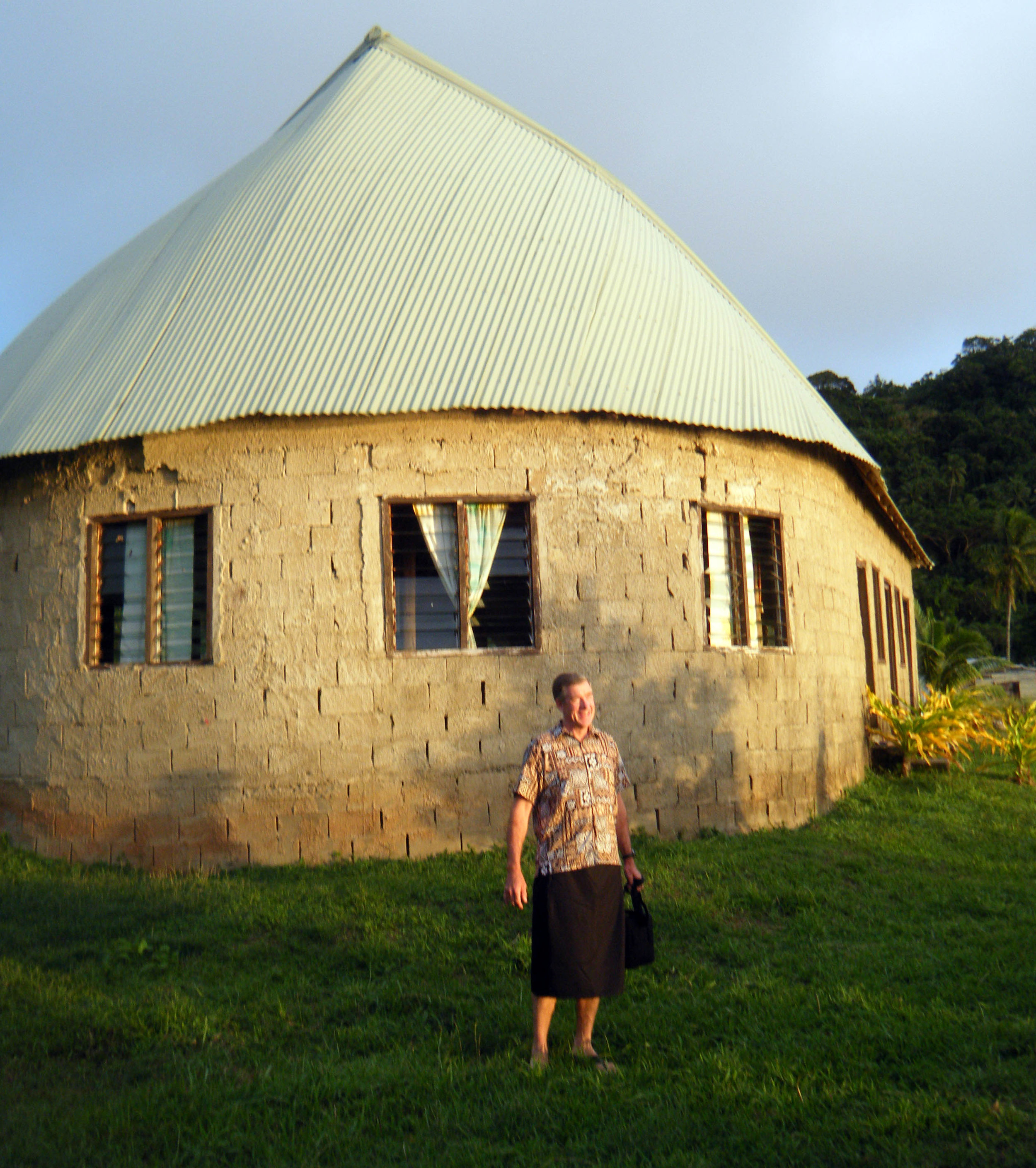 Phil and traditional house.jpg