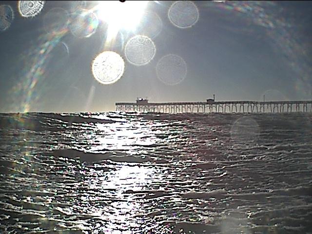sun falling on atlantic beach.JPG