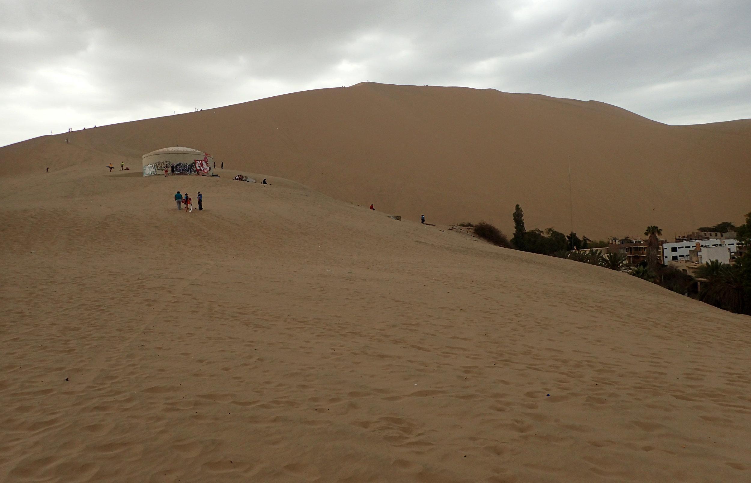 ascending the dunes behind town.jpg