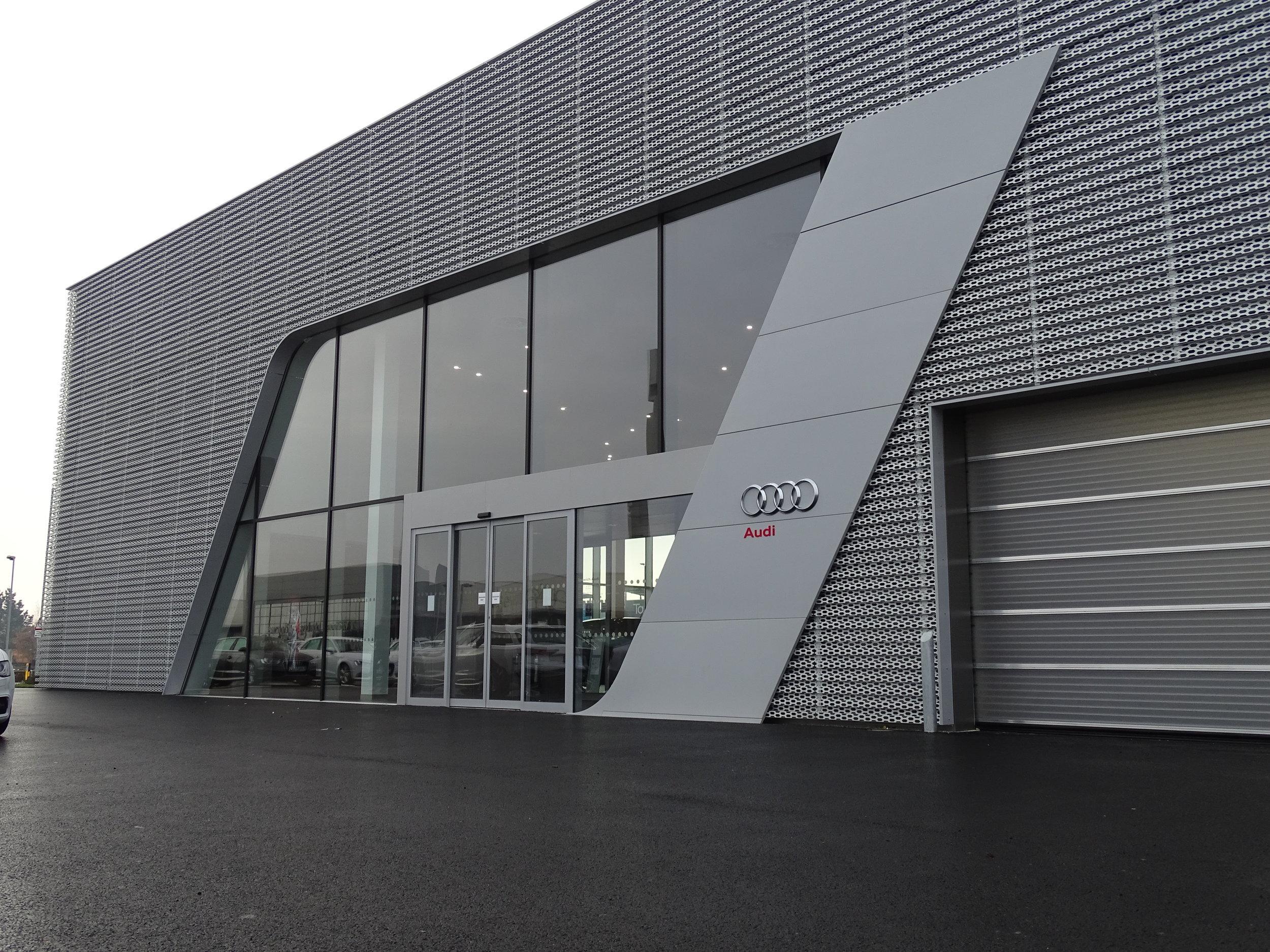 EDM Spanwall anodised aluminium perforated rainscreen cladding and PPC Aluminium curved bespoke flashings