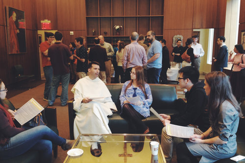 Fr. Dominic Legge, OP with NYU students during a break at his a  'Wisdom of Aquinas ' lecture.