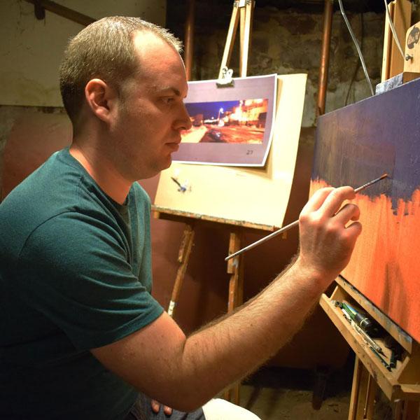 Patrick Seufert painting in his studio