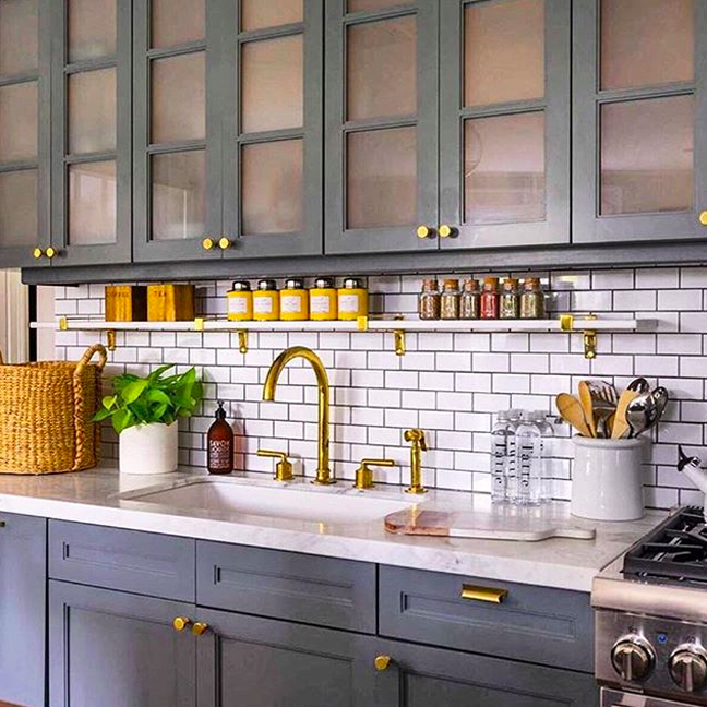 Henry (in unlacquered brass) ties it all together in a #Boston kitchen by@lizcaan. #WaterworksKitchen