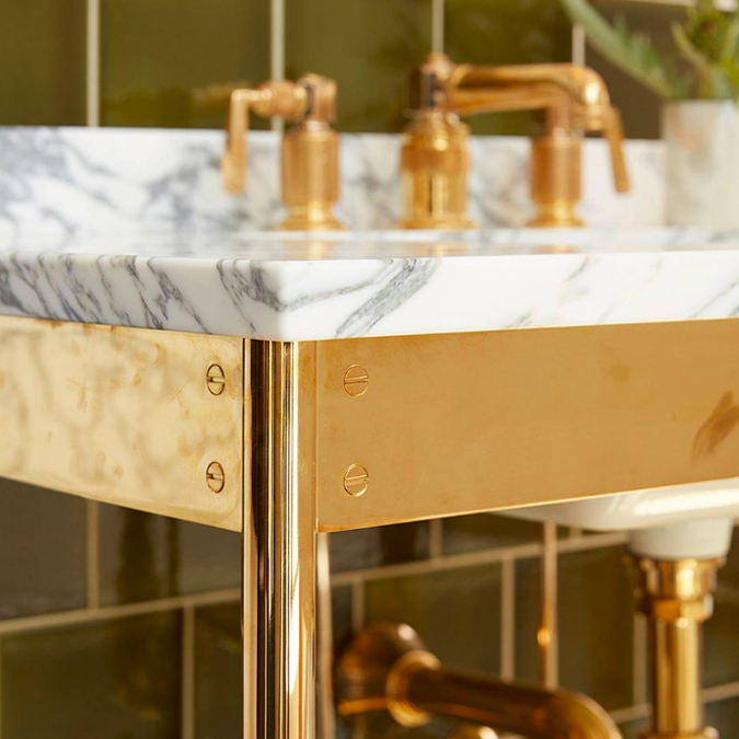 """A collaboration with Roman and Williams, the unlacquered brass of our R.W. Atlas collection takes on a timeless patina that gets even better with age. #ThePerfectBath"
