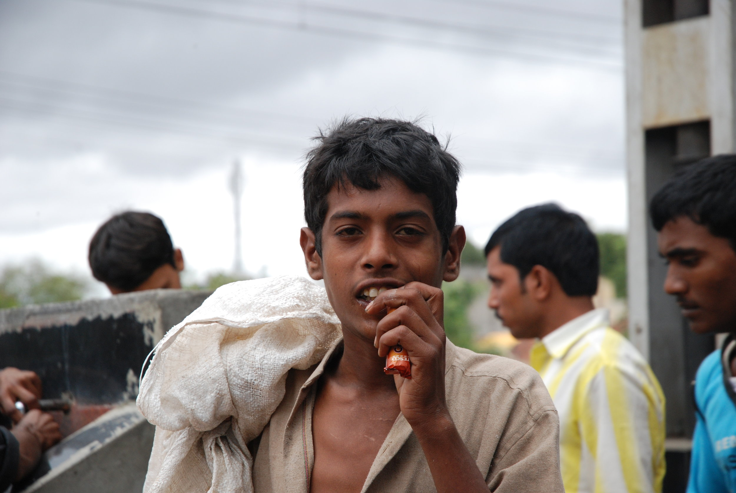 Young poor man on platform - great picture.JPG