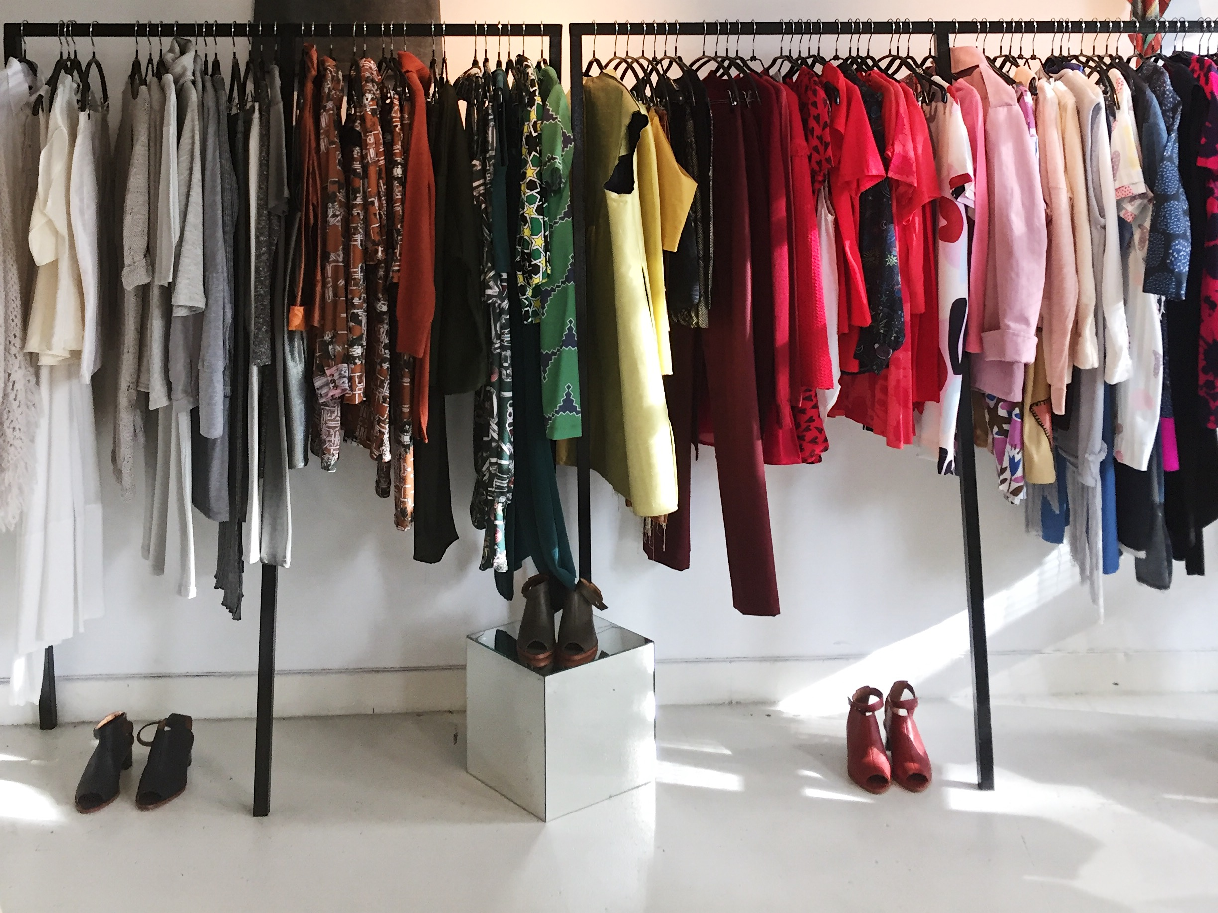 Rainbow-colored racks show off locally designed threads at Maria Lee's sunny boutique.